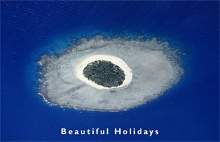 aerial view of an uninhabited coral island in Tonga